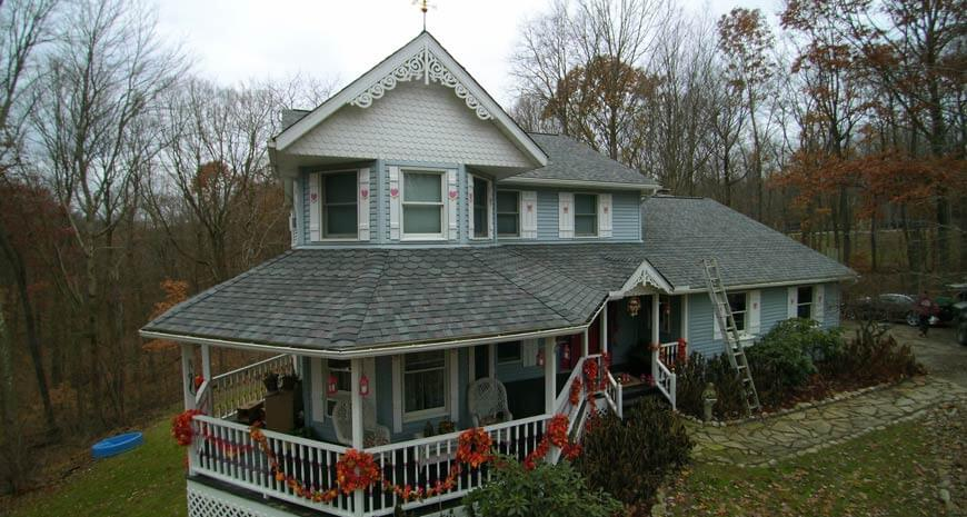 Amish asphalt shingle installation by Charm Builders