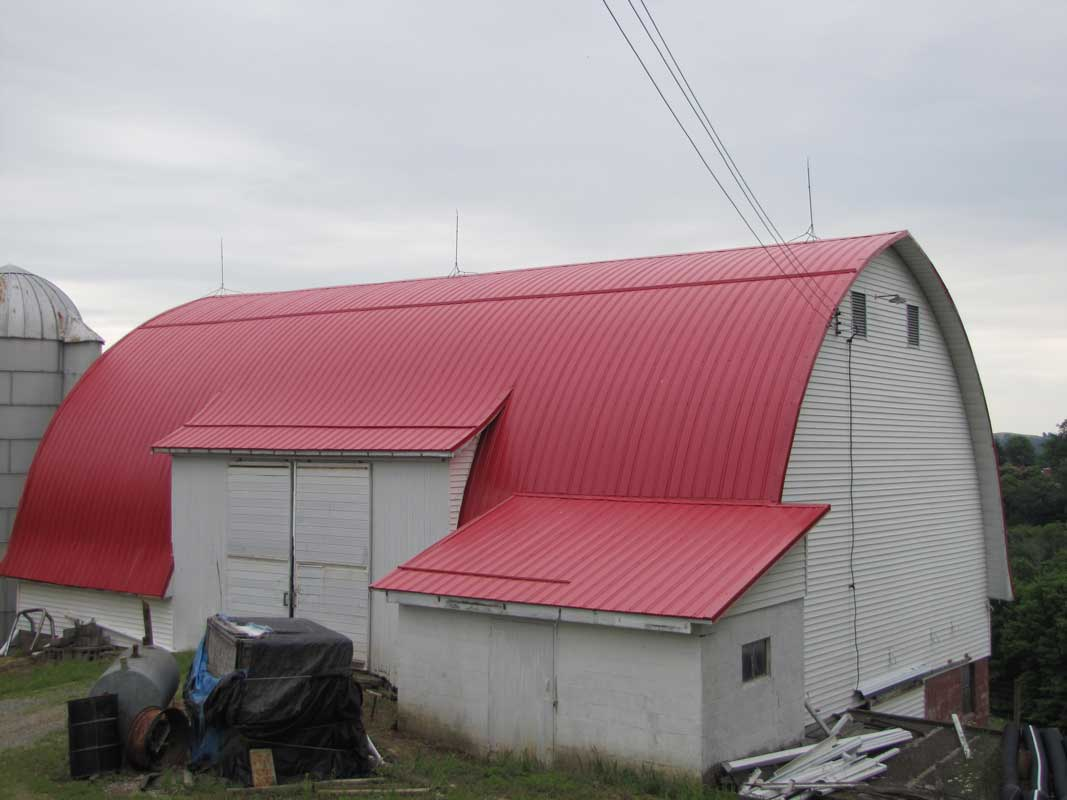 Red metal roofing on a barn
