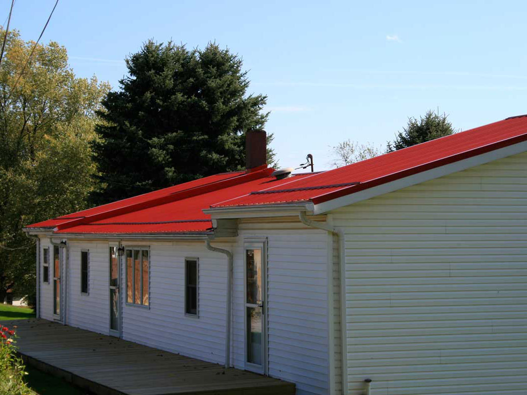 House with Red Metal Roofing